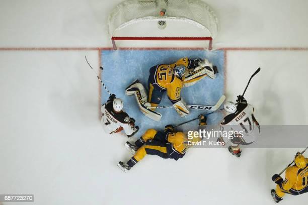 NHL Playoffs Aerial view of Nashville Predators goalie Pekka Rinne in action vs Anaheim Ducks Ryan Kesler at Bridgestone Arena Game 4 Nashville TN...