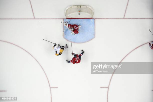 NHL Playoffs Aerial view of Washington Capitals goalie Braden Holtby and TJ Oshie in action vs Pittsburgh Penguins Olli Maatta at Verizon Center Game...