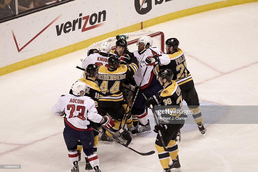 Boston Bruins Andrew Ference (21) in action, scrum vs Washington Capitals Joel Ward (42) at TD Garden. Game 7. Michael J. Clarke F58 )