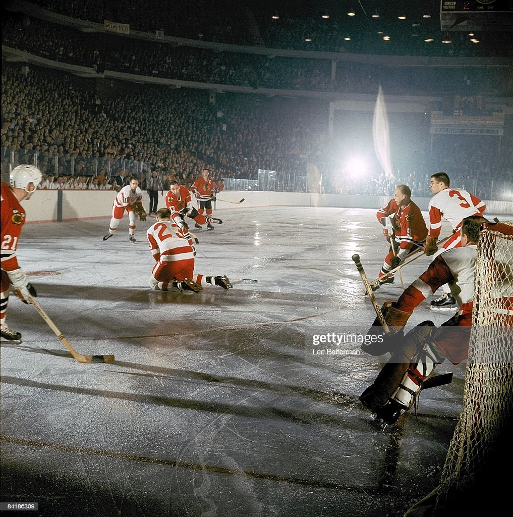 Chicago Blackhawks Ken Wharram (17) in action, shot vs Detroit Red Wings Warren Godfrey (23). Chicago, IL 4/7/1966