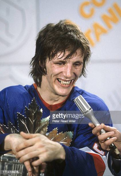 NHL Playoffs Closeup of New York Islanders Mike Bossy victorious with Conn Smythe Trophy for playoff MVP during media interview after winning Game 4...