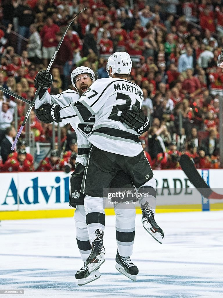 Los Angeles Kings Alec Martinez (27) victorious after scoring game winning goal with Tyler Toffoli (73) vs Chicago Blackhawks at United Center. Game 7. David E. Klutho TK1 )