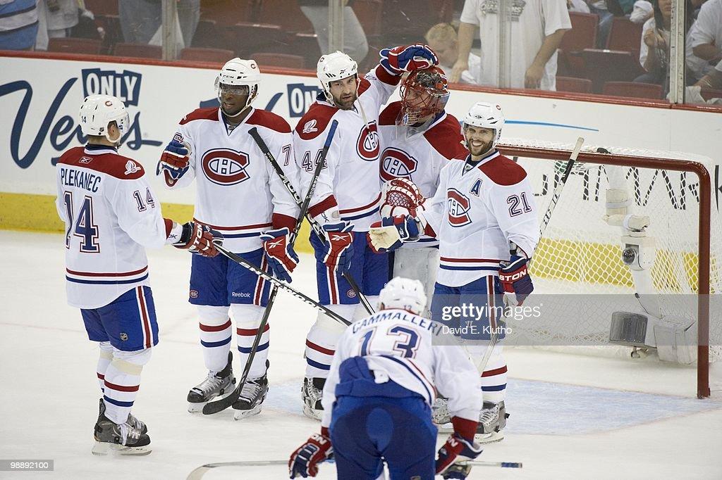 NHL Playoffs Montreal Canadiens goalie Jaroslav Halak Brian Gionta and Roman Hamrlik victorious after winning Game 2 vs Pittsburgh Penguins...