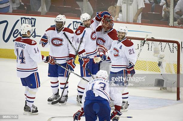 NHL Playoffs Montreal Canadiens goalie Jaroslav Halak Brian Gionta and Roman Hamrlik victorious after winning Game 2 vs Pittsburgh Penguins...