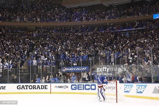 NHL Playoffs New York Rangers goalie Henrik Lundqvist during game with fans in stands cheering in background vs Tampa Bay Lightning at Madison Square...
