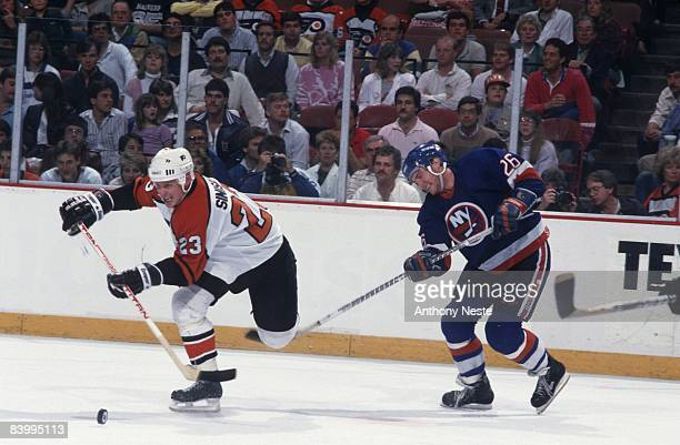 NHL Playoffs Philadelphia Flyers Ilkka Sinisalo in action vs New York Islanders Pat Flatley Game 7 Philadelphia PA 5/2/1987 CREDIT Anthony Neste