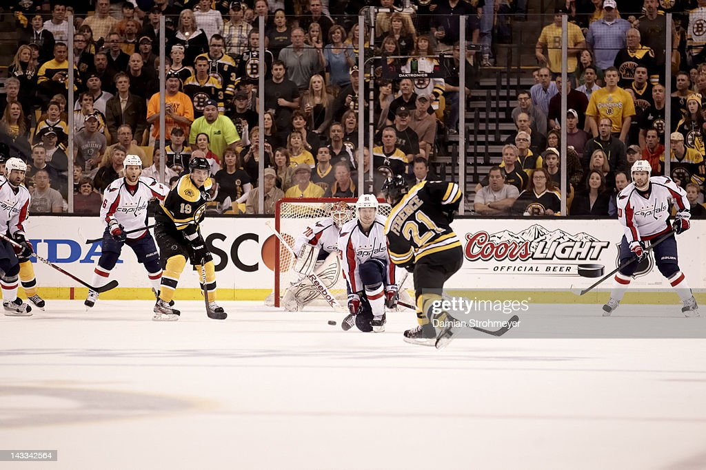 Washington Capitals Jay Beagle (83) and goalie Braden Holtby (70) in action vs Boston Bruins Andrew Ference (21) at TD Garden. Game 5. Damian Strohmeyer F107 )