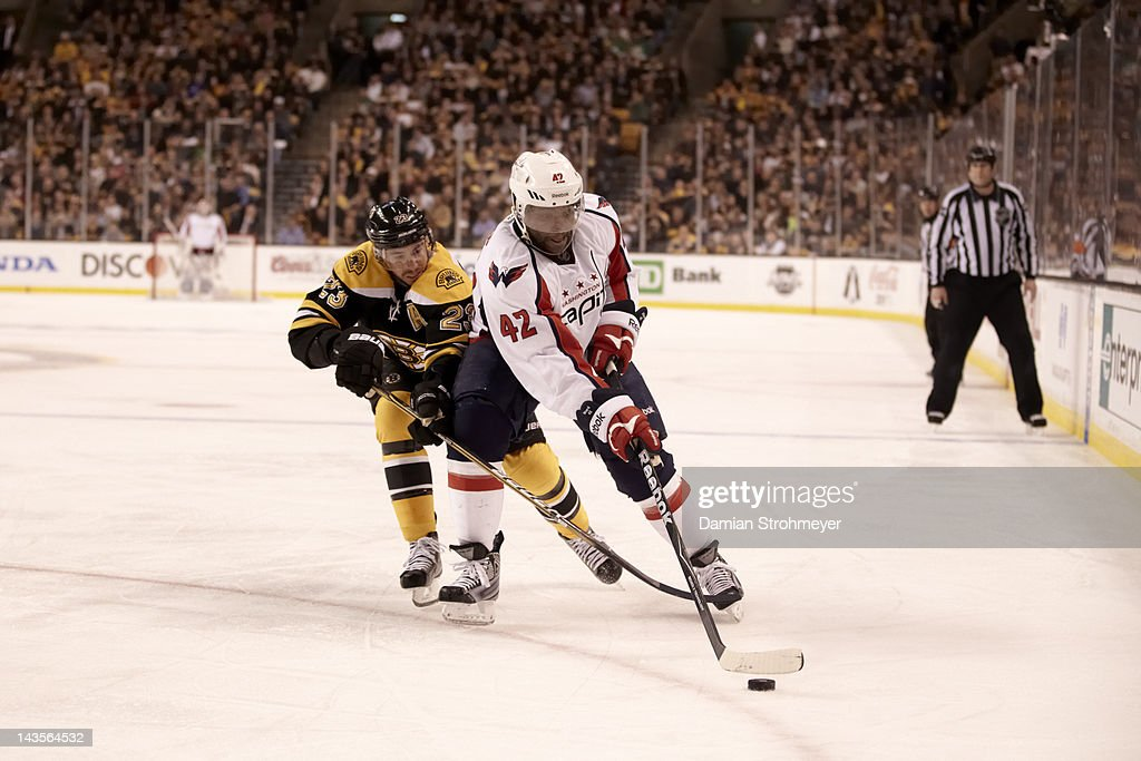 Washington Capitals Joel Ward (42) in action vs Boston Bruins Chris Kelly (23) at TD Garden. Game 7. Damian Strohmeyer F67 )