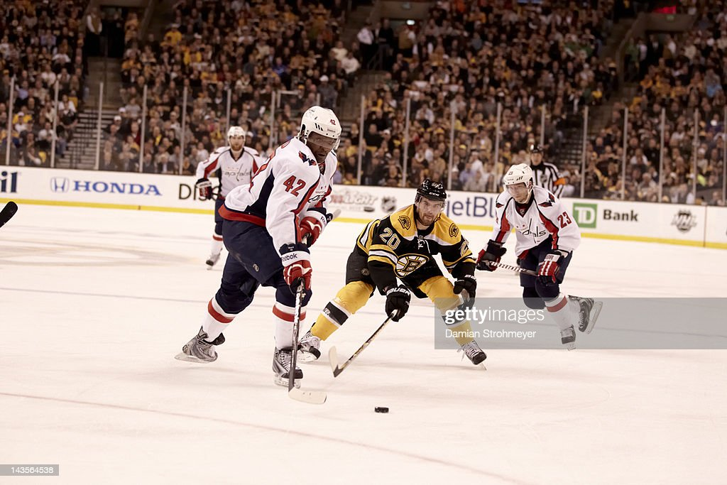 Washington Capitals Joel Ward (42) in action vs Boston Bruins Daniel Paille (20) at TD Garden. Game 7. Damian Strohmeyer F49 )