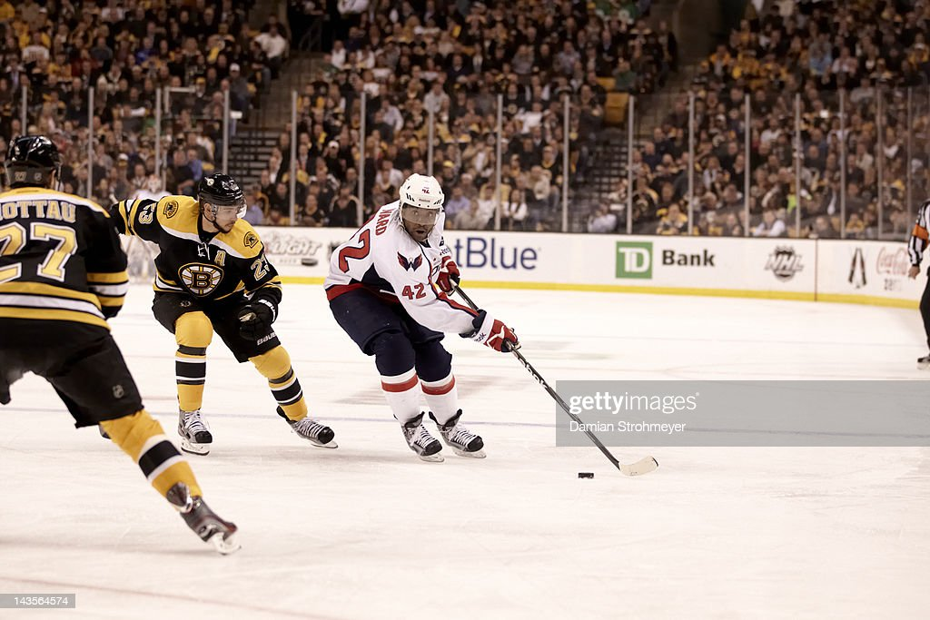 Washington Capitals Joel Ward (42) in action vs Boston Bruins Chris Kelly (23) at TD Garden. Game 7. Damian Strohmeyer F57 )