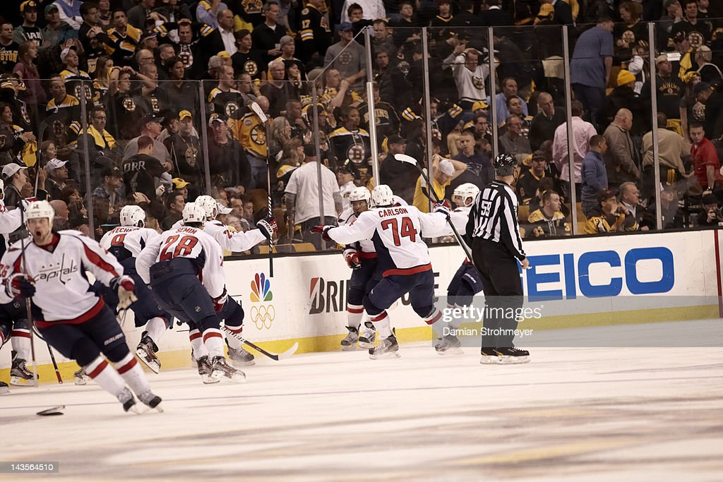 Washington Capitals Joel Ward (42) victorious with teammates after winning game vs Boston Bruins at TD Garden. Game 7. Damian Strohmeyer F58 )