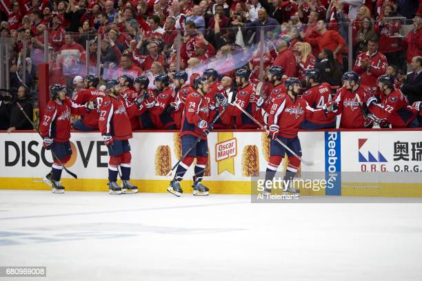 NHL Playoffs Washington Capitals TJ Oshie Karl Alzner John Carlson and Marcus Johansson victorious with teammates at bench during game vs Pittsburgh...