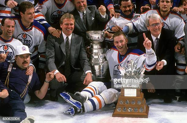 NHL Stanley Cup Finals Team photo of Edmonton Oilers with coach Glen Sather owner Peter Pocklington Grant Fuhr and Wayne Gretzky victorious with...