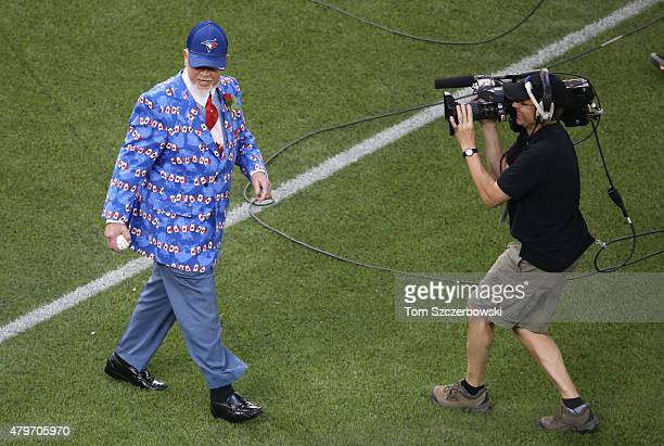 Hockey personality Don Cherry walks to the mound to throw out the ceremonial first pitch on Canada Day before the start of the Toronto Blue Jays MLB...