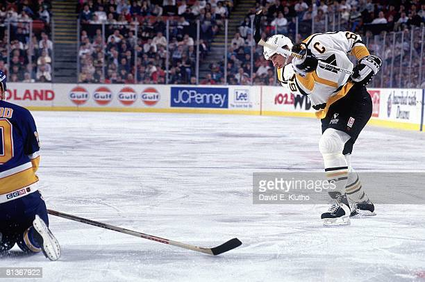 Hockey Pittsburgh Penguins Mario Lemieux in action taking shot vs St Louis Blues Lee Norwood during preseason Pittsburgh PA 11/5/1992