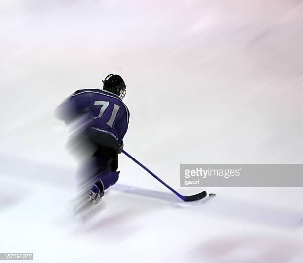 Jugador de Hockey acción de disparo