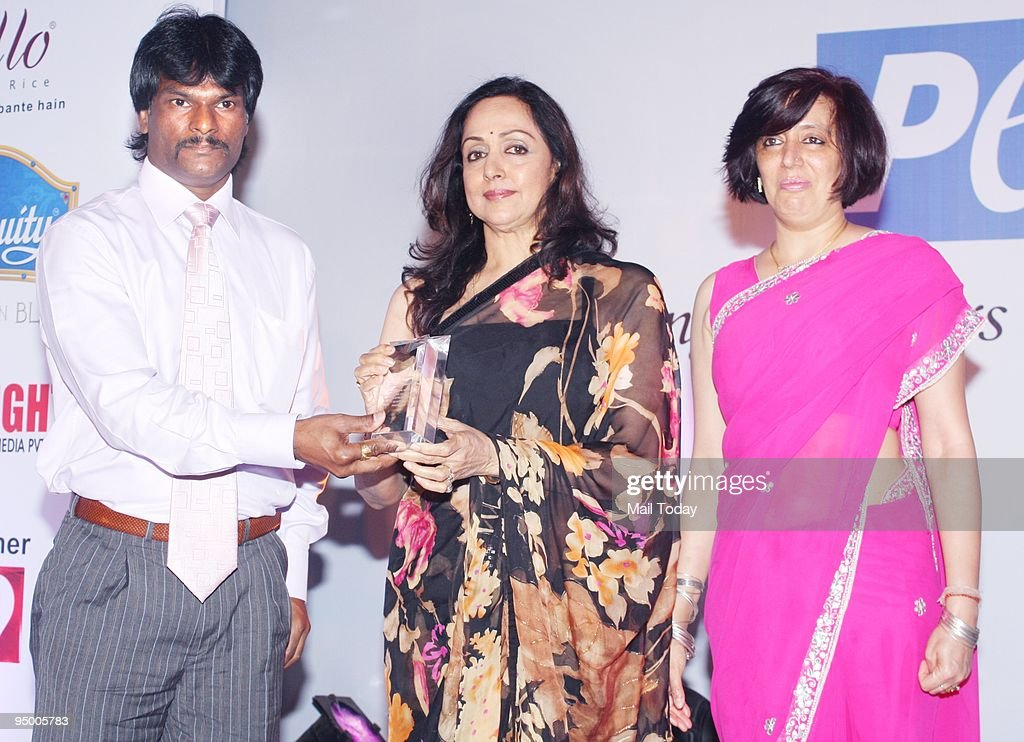 Hockey player Dhanraj Pillai and actress <a gi-track='captionPersonalityLinkClicked' href=/galleries/search?phrase=Hema+Malini&family=editorial&specificpeople=1026787 ng-click='$event.stopPropagation()'>Hema Malini</a> at an event to celebrate People for Ethical Treatment of Animals(PETA) India's 10th anniversary in Mumbai on Friday, December 18, 2009.