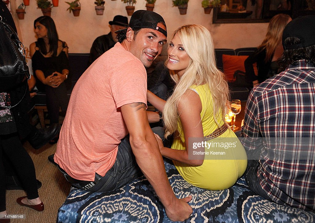 Hockey player Sheldon Souray and Marni Blank attend Rande Gerber and Cindy Crawford's pre 4th of July party sponsored by Caliche Rum at Cafe Habana...
