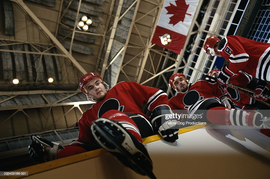 Hockey players climbing onto ice, low angle view : Stock Photo