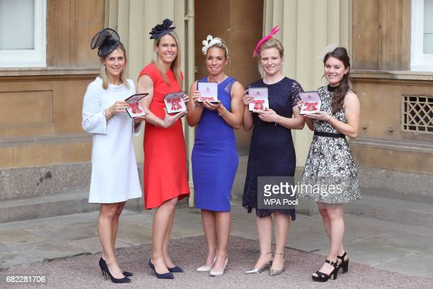 Hockey players Georgina Twigg Crista Cullen Susannah Townsend Hollie Webb and Laura Unsworth pose after they were awarded MBEs by the Duke of...
