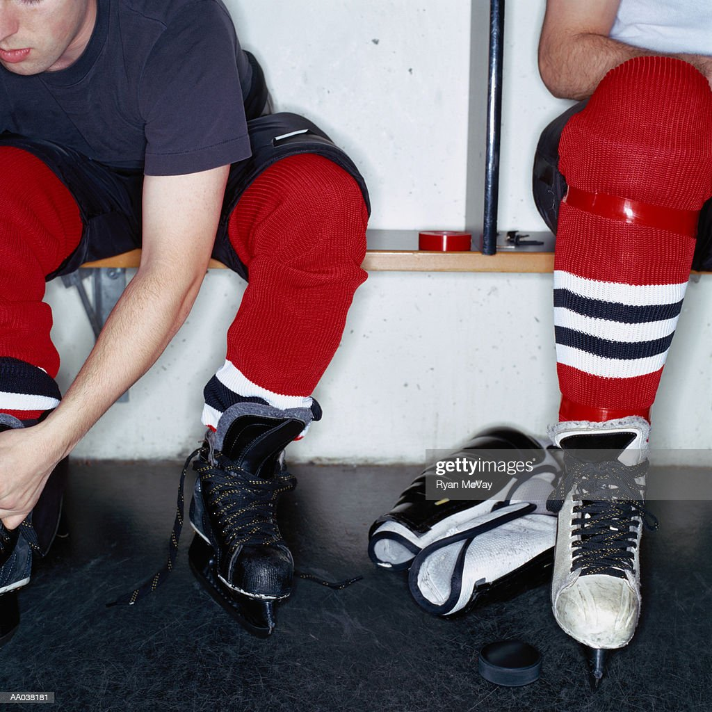 Hockey Players in Locker Room