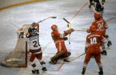 US hockey players John Harrington and Michael Ramsey react after the puck was fired into the net for a goal past Soviet goalkeeper Vladimir Myshkin...