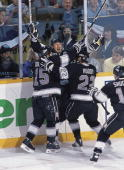 Hockey playoffs Los Angeles Kings Wayne Gretzky victorious with team after scoring 3rd goal during game hat trick vs Toronto Maple Leafs Toronto CAN...
