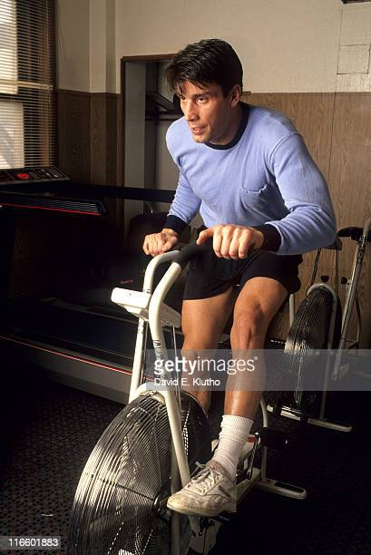 Portrait of Boston Bruins Cam Neely on exercise bicycle during workout at Boston Garden Boston MA CREDIT David E Klutho