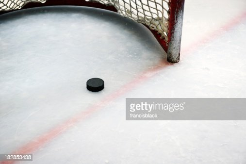 Hockey puck in goal and red line