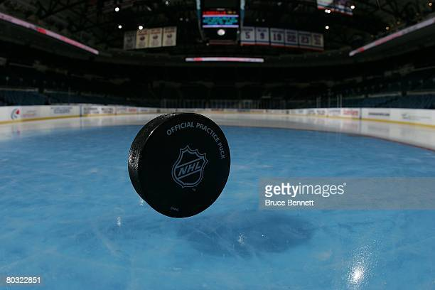 A hockey puck on the ice photographed on March 18 2008 prior to the game between the Toronto Maple Leafs and the New York Islanders at the Nassau...