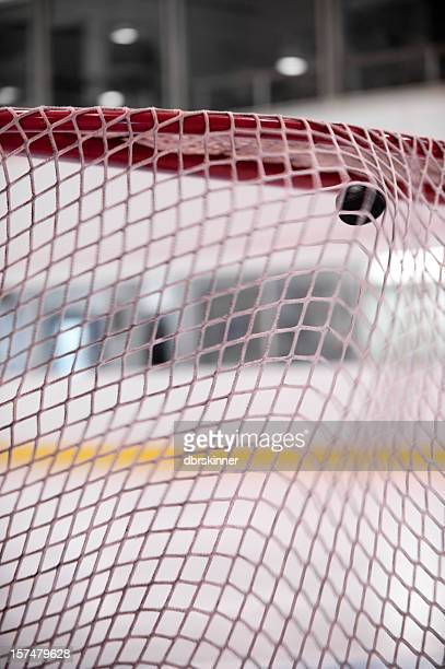 Hockey puck shot into the net
