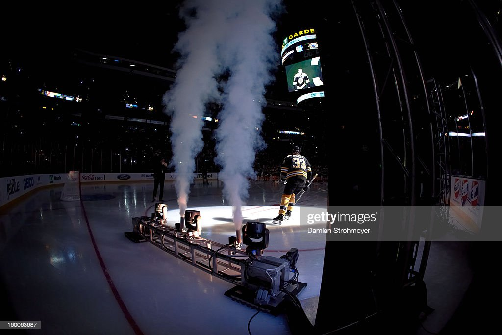 Rear view of Boston Bruins Zdeno Chara (33) entering ice before game vs New York Rangers Mike Rupp (17) at TD Garden. Damian Strohmeyer F19 )
