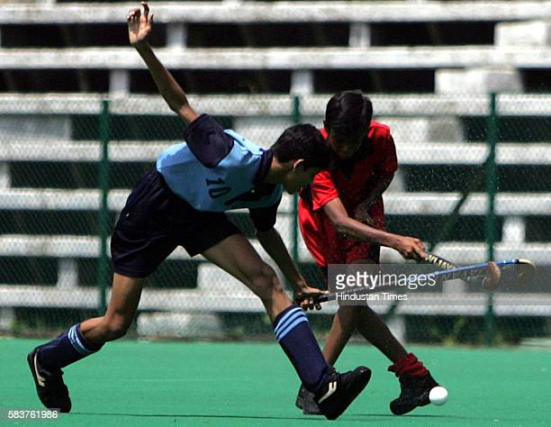 Hockey SANDEEP SINGH AND TAHIR KHAN OF ST ANDREW'S FIGHT FOR THE BALL DURING THE SEMI FINAL OF 'LATE MAJOR DHYAN CHAND INTER SCHOOL HOCKEY TOURNAMENT...