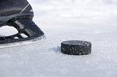 black hockey skate and puck