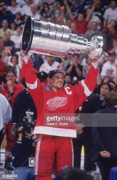 Hockey Stanley Cup finals Detroit Red Wings Steve Yzerman victorious with trophy after winning game vs Washington Capitals Washington DC 6/16/1998