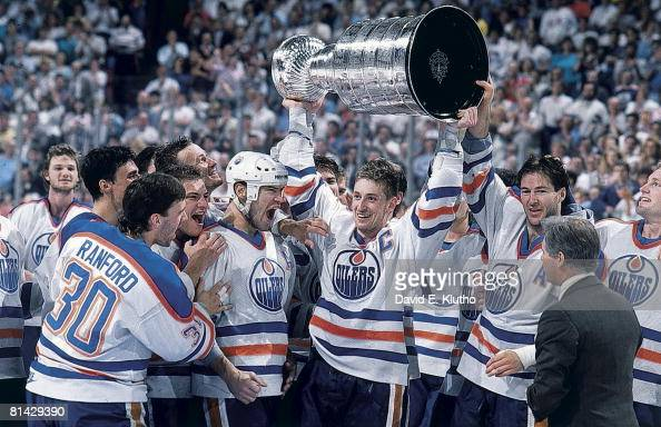 Hockey Stanley Cup finals Edmonton Oilers Bill Ranford Esa Tikkanen Mark Messier Wayne Gretzky and Kevin Lowe victorious with trophy after winning...