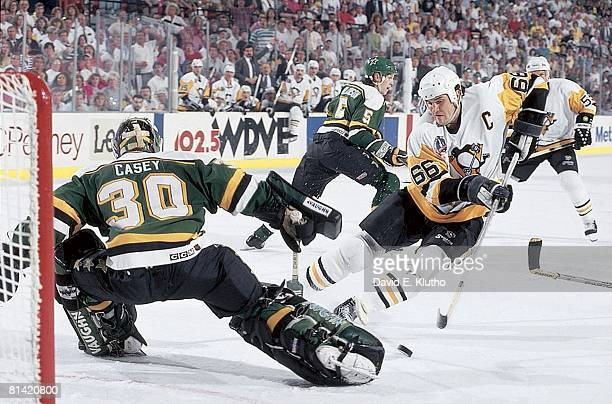 Hockey Stanley Cup finals Pittsburgh Penguins Mario Lemieux in action scoring goal vs Minnesota North Stars goalie Jon Casey Pittsburgh PA 5/15/1991