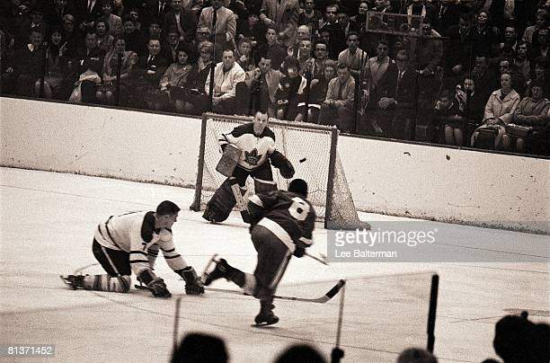 Hockey Stanley Cup Finals Toronto Maple Leafs goalie Johnny Bower in action vs Detroit Red Wings Pit Martin 4/16/19644/25/1964
