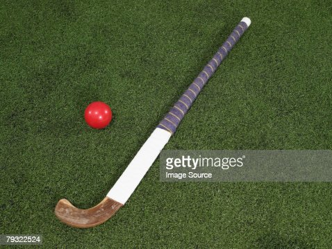 A hockey stick and a ball