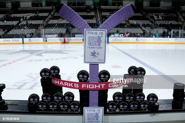 Hockey stick and puck art on display commemorating Hockey Fights Cancer night prior to a game between the San Jose Sharks and the Boston Bruins at...