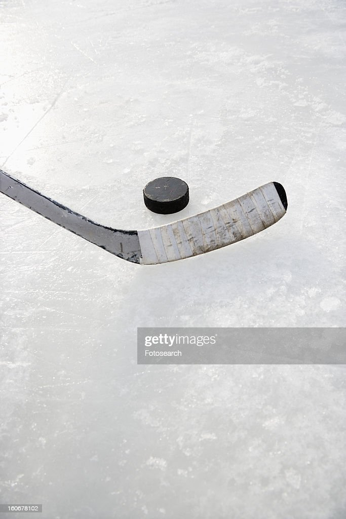 Hockey stick on ice rink to hit puck