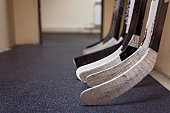 Hockey sticks in locker rooms before the game