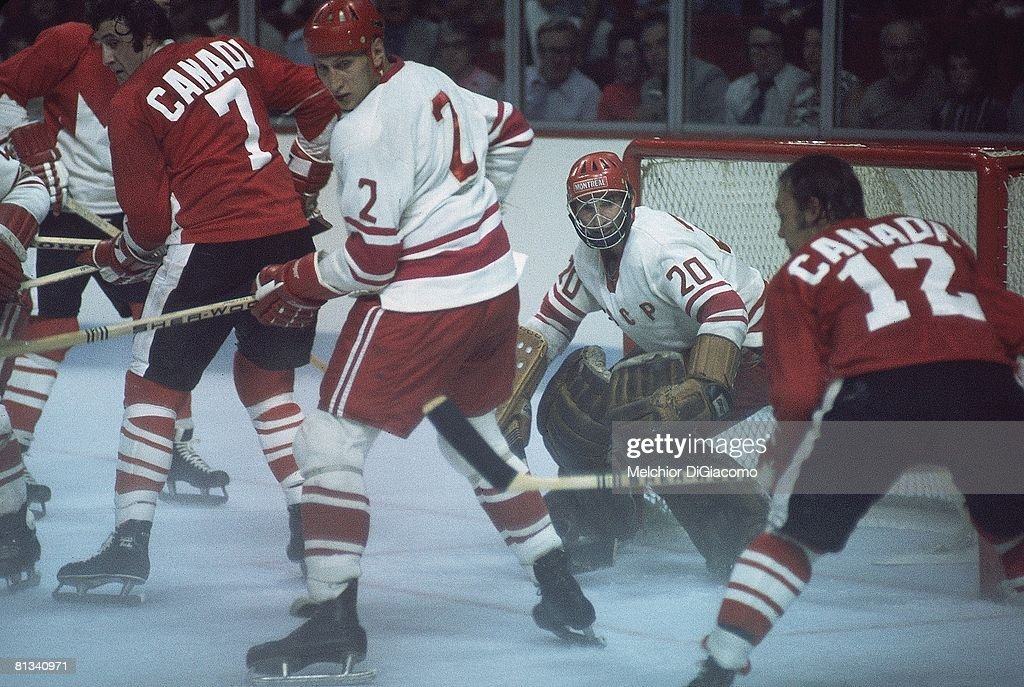 The Summit Series, Soviet Union goalie Vladislav Tretiak #20 and Alexander Gusev #2 defend the net as Yvan Cournoyer #12 and <a gi-track='captionPersonalityLinkClicked' href=/galleries/search?phrase=Phil+Esposito&family=editorial&specificpeople=214575 ng-click='$event.stopPropagation()'>Phil Esposito</a> #7 of Canada wait for the shot during Game 1, Montreal, Canada 9/2/1972