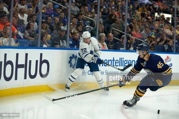 Toronto Maple Leafs Nikita Zaitsev in action shooting vs Buffalo Sabres Brendan Guhle at KeyBank Center Buffalo NY CREDIT David E Klutho