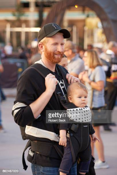 Vegas Golden Knights fan holding baby on carrier waiting outside TMobile Arena before game vs Arizona Coyotes Las Vegas NV CREDIT Robert Beck