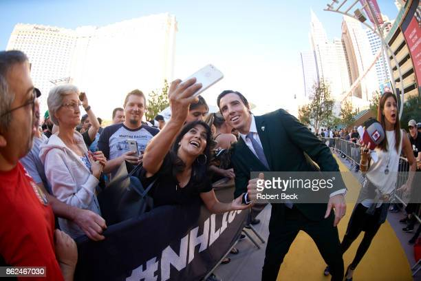 Vegas Golden Knights goalie MarcAndre Fleury posing for selfie with fan outside TMobile Arena before game vs Arizona Coyotes Las Vegas NV CREDIT...