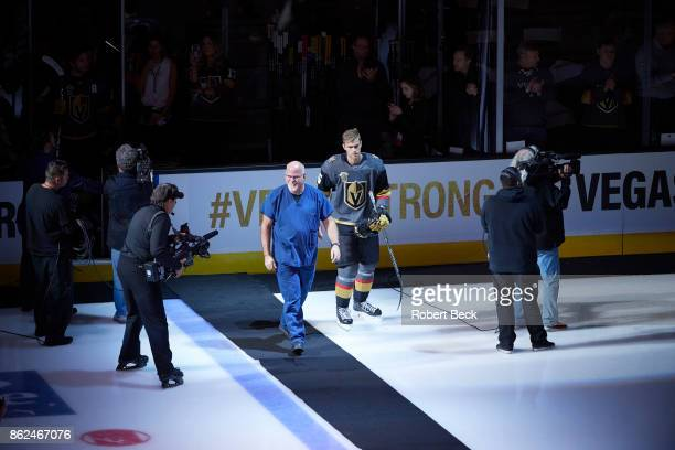 View of local hospital worker walking on the ice during ceremony before Vegas Golden Knights vs Arizona Coyotes at TMobile Arena Las Vegas NV CREDIT...
