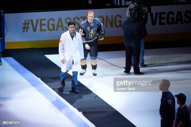 View of UNLV School of Medicine doctor walking on the ice during ceremony before Vegas Golden Knights vs Arizona Coyotes at TMobile Arena Las Vegas...