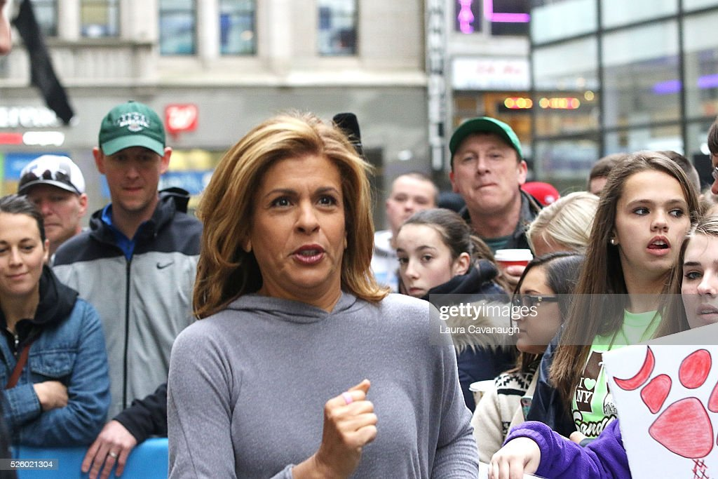 <a gi-track='captionPersonalityLinkClicked' href=/galleries/search?phrase=Hoda+Kotb&family=editorial&specificpeople=2338013 ng-click='$event.stopPropagation()'>Hoda Kotb</a> runs through the crowd at NBC's 'Today' at Rockefeller Plaza on April 29, 2016 in New York City.
