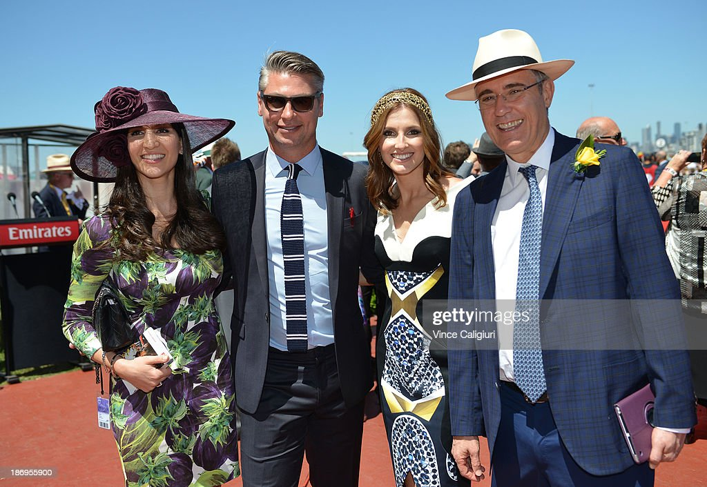 Hoda Vakili, Luke Ricketson, Kate Waterhouse and Robbie Waterhouse celebrate the win of Gai Waterhouse after Fiorente won the Emirates Melbourne Cup during Melbourne Cup Day at Flemington Racecourse on November 5, 2013 in Melbourne, Australia.